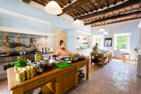 Radha and Teri in their Tuscany kitchen